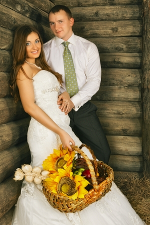 charming bride and groom in hayloft at summer day photo