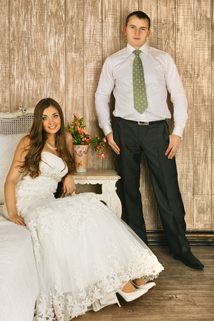 charming bride and groom in their bedroom photo