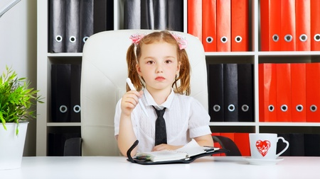 little girl as a businesswoman, in office photo