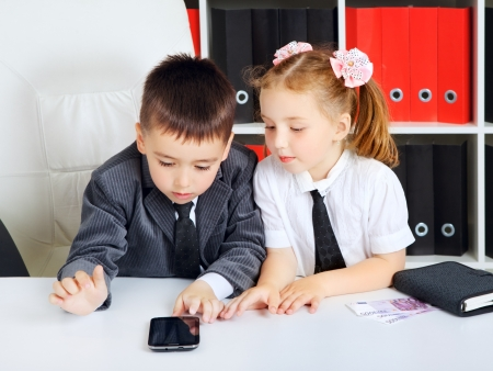 little children as a businessmen, in office Stock Photo