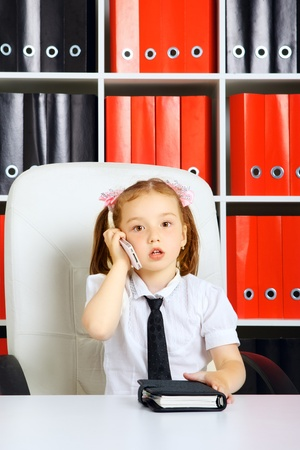 business suit: little girl as a businesswoman, in office Stock Photo