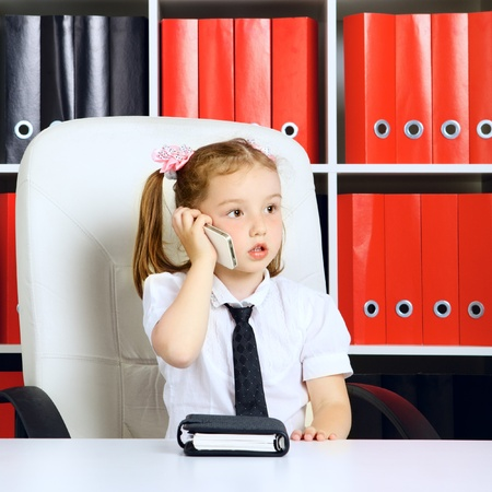 diary: little girl as a businesswoman, in office Stock Photo
