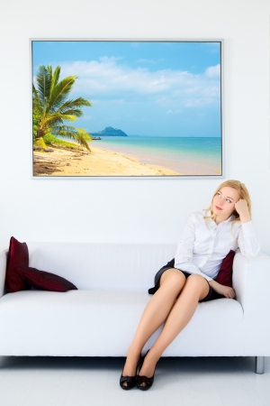 businesswoman legs: cute businesswoman legs sitting on sofa and dream about vacation