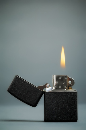 black gasoline lighter with flame photo