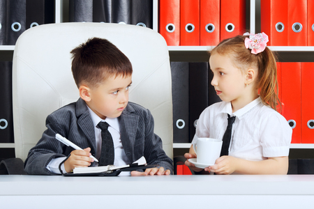 little children as a businessmen, in office photo