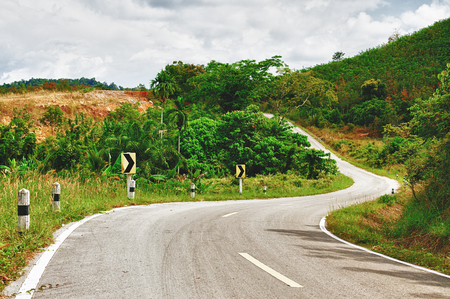 asphalt highway in jungle, Koh Lanta Noi, Thailand photo