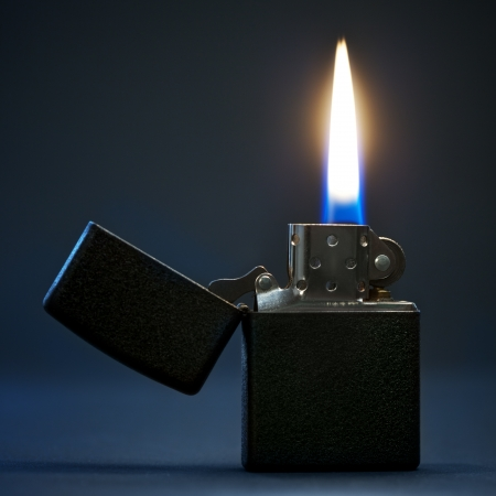 black gasoline lighter with flame  Stock Photo