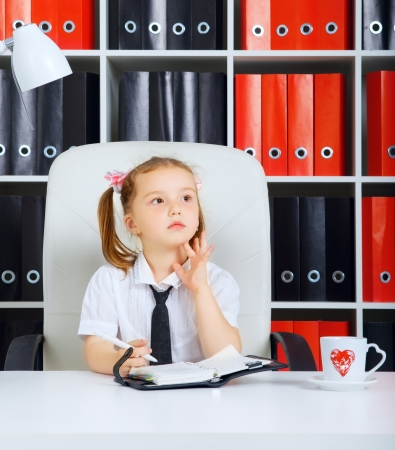 little girl as a businesswoman, in office Stock Photo