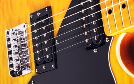 vintage yellow six-string electric guitar, close up photo