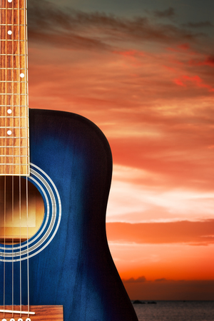 blue classic acoustic guitar, on nature background photo