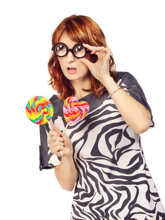crazy woman in funny eyeglasses with lollipop photo