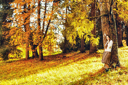 beautiful smiling young girl in autumn forest photo