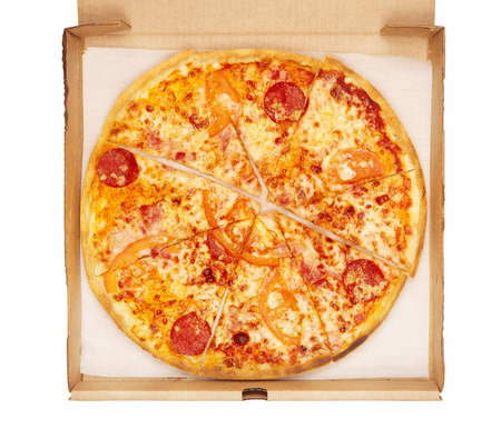 fresh pizza in box, isolated on white photo