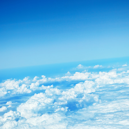 clouds in a blue sky, view from airplane photo