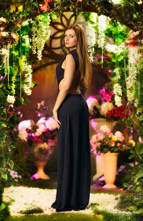 beautiful elegant woman in garden, stidio shot photo