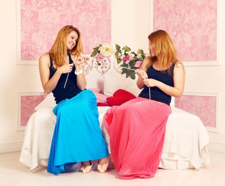 two young sexy girls in pink bedroom photo