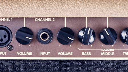 reverb: retro guitar amplifier control panel with knobs