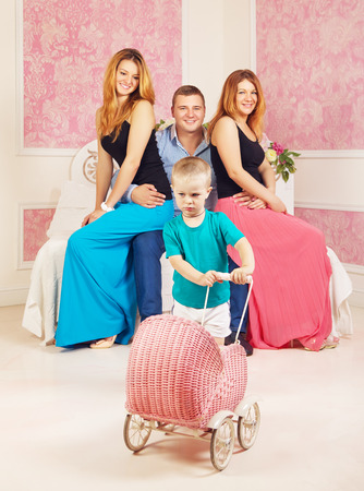 happy man with two women and resentful child photo