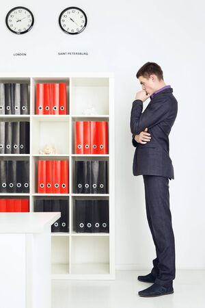 lost in thought: businessman lost in thought in his office Stock Photo