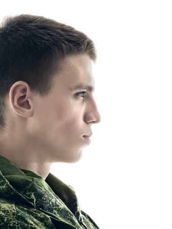 fatigues: young military man profile, closeup portrait isolated on white Stock Photo