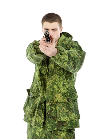 sighting: young military man sighting with gun, isolated on white