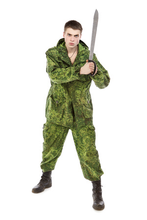 onslaught: young military man with machete, isolated on white Stock Photo
