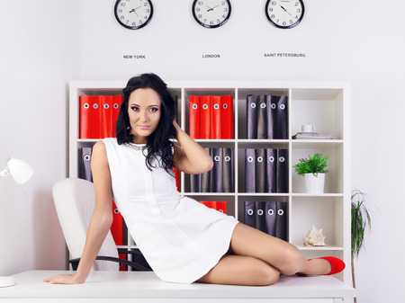 provocative: sexy provocative businesswoman at office on table