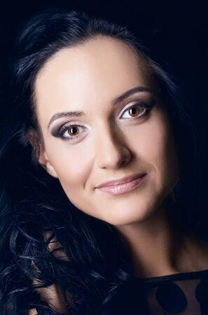 beautiful young woman studio portrait, black background photo