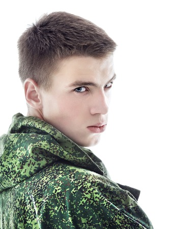 fatigues: young military man, closeup portrait isolated on white Stock Photo