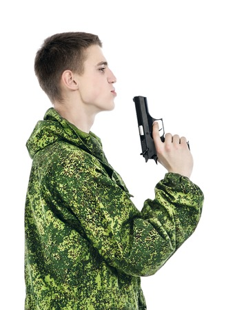 young military man with gun, isolated on white photo