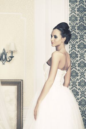 beautiful young woman in wedding dress, interior photo