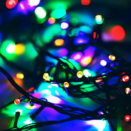 rosso verde: defocused electric garland with red, green and blue lights Archivio Fotografico