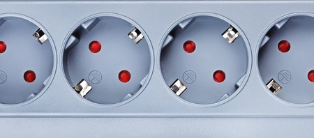 protector: gray surge protector sockets, close up view