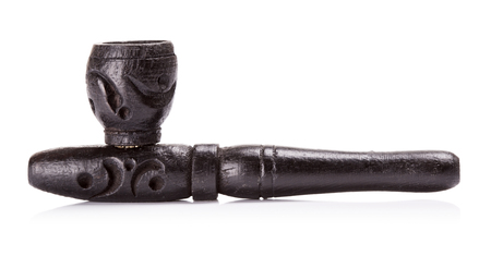 hashish: black wooden hashish pipe, isolated on white background