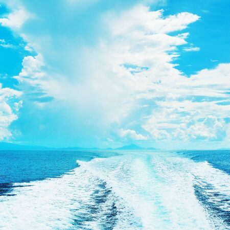 speedboat: sea with trail of speedboat at sunny day Stock Photo
