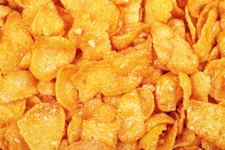 nourish: cornflakes with honey and nuts, closeup background