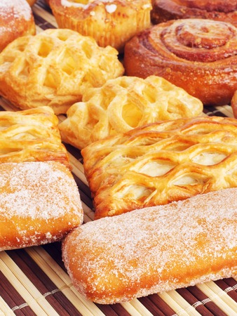 various fresh sweet homemade buns on table