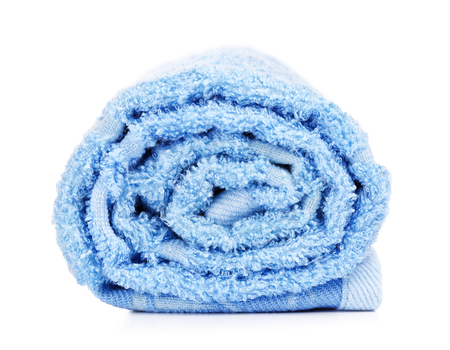 terrycloth: rolled up blue bath towel, isolated on white background