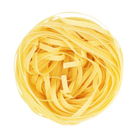 maccheroni: raw pasta tagliatelle nest, isolated on white