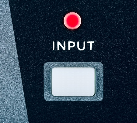amplifier: gray amplifier input button, close up shot Stock Photo