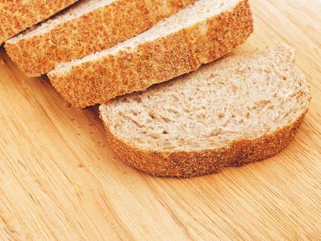 wholegrain mustard: sliced wholegrain white bread lying on cutting board