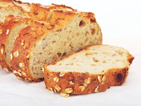 wholegrain: sliced wholegrain bread with oats and nuts, on paper