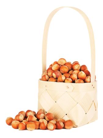 hazelnuts in wooden basket, isolated on white background Stok Fotoğraf