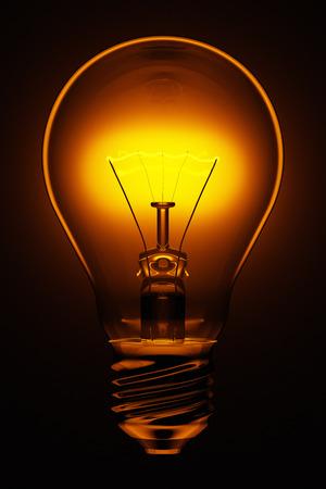 glowing electric light bulb, 3d render, dark background