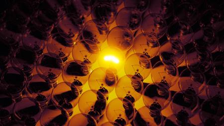 glowing electric light bulb amongst dark group, 3d render