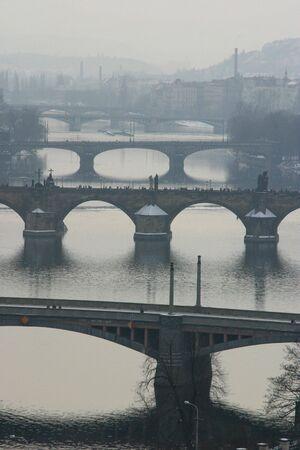 Misty view of Pragues bridges (including Charles Bridge)