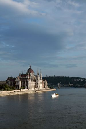 Budapest parliament on the Danube bankside and tourist boat Stock Photo - 514680