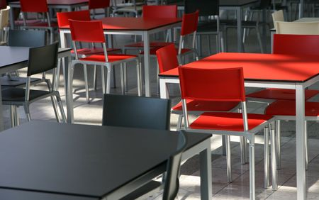 Modern tables and chairs in a cafeteria Stock Photo