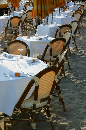 View of empty tables of a beach restaurant Stock Photo
