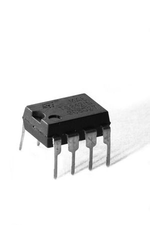 Black and white macro shot of an electronic device, isolated on white (operational amplifier)